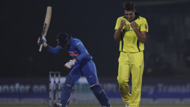 Pat Cummins celebrates taking the wicket of India's Kedar Jadhav in the final ODI.