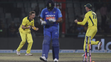 Adam Zampa (left) celebrates the wicket of India's Rohit Sharma in the final one-day international in Delhi this summer.