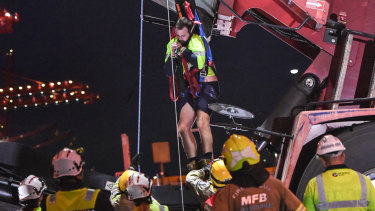 A man trapped after a crane flipped over is freed.