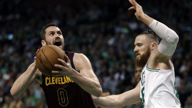 Aron Baynes puts pressure on the Cavs' Kevin Love.
