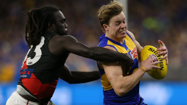 Anthony McDonald-Tipungwuti of the Bombers tackles Jackson Nelson of the Eagles.