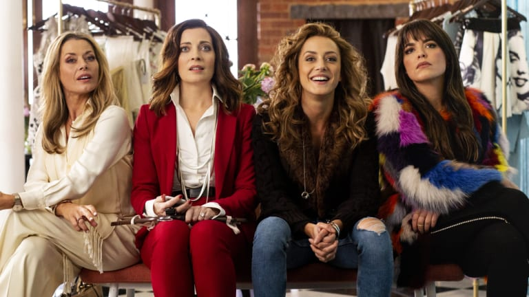 Footballers' wives: Madeleine West, Annie Maynard, Isabella Giovinazzo and Olympia Valance in <i>Playing for Keeps</i>.