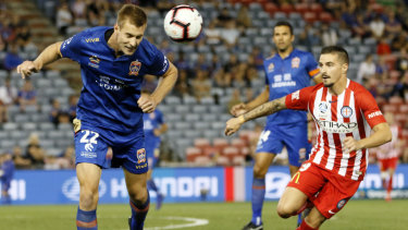 Newcastle's Lachlan Jackson clears from defence as dangerous City striker Jamie MacLaren  lurks.