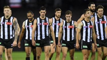 Downcast: Magpies leave the field after registering their lowest game score in 24 years.