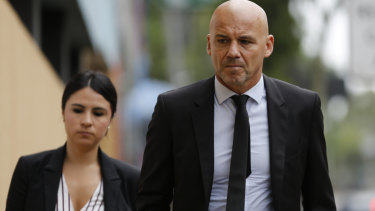 Detective Chief Inspector Gary Jubelin (right) arrives at the Glebe Coroners Court on Wednesday.
