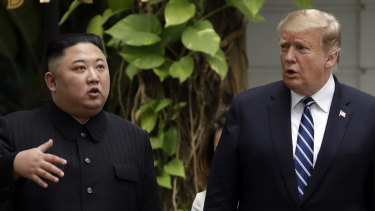 Kim Jong-un and Donald Trump go for a walk in the garden after their first meeting in Hanoi.