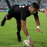 Rieko Ioane of the All Blacks scores a try.