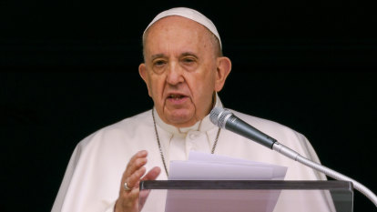 Pope Francis alert and well a day after surgery, Vatican says