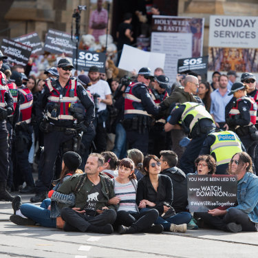 Police move in on protesters blocking streets at Melbourne's Flinders Street Station in April.