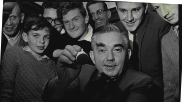 Russian Grand champion Alexander Kotov is surrounded by chess fans when he toured Australia in 1963.