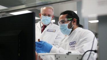 Prime Minister Scott Morrison meets with team member Gaby Atencio in the Analytical Laboratory at AstraZeneca in Sydney in August.