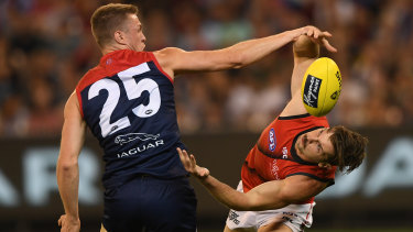 Unorthodox: Essendon's Patrick Ambrose approaches his contest with Tom McDonald from a new angle.