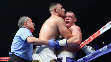 Justis Huni tangles with Paul Gallen.