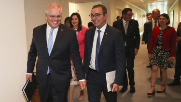 Prime Minister Scott  Morrison with state and territory leaders after the first in-person national cabinet meeting, in December.