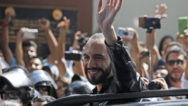 Presidential hopeful Nayib Bukele waves as he leaves a polling station after casting his vote in the presidential election in San Salvador on  Sunday.