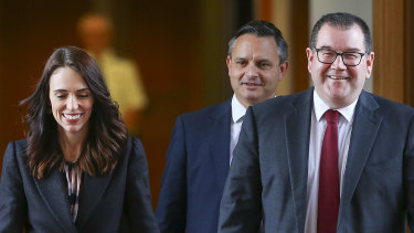 From left: New Zealand Prime Minister Jacinda Ardern, Finance Minister Grant Robertson and Climate Change Minister James Shaw at Parliament in Wellington.