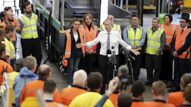 Opposition Leader Bill Shorten speakers to workers at the Volgren bus facility in Perth on Wednesday.