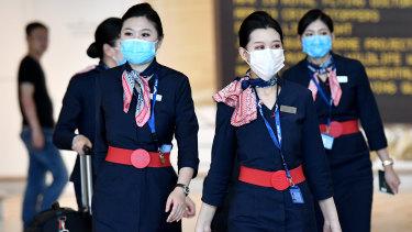 China Eastern Airlines cabin crew wear face masks at Brisbane International Airport last week.