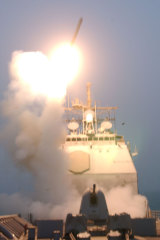 The first Tomahawk missile to be fired into Iraq is launched from the USS Bunker Hill.