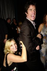 Megan Fowler pounces on Ronn Moss  at a radio function in 2004.