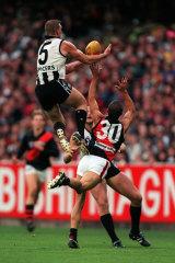 Nathan Buckley soaring over Mark Fraser.
