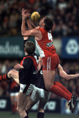 Tony Lockett goes up for a mark.