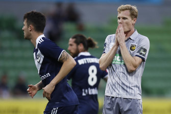 Matt Simon. who scored the Mariners' goal, reacts after a missed shot.