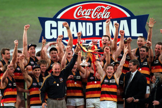 The Crows celebrate winning the 1998 grand final.
