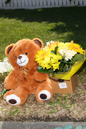 Flowers and other items were still being left at the scene on Saturday, three days after the murder-suicide.