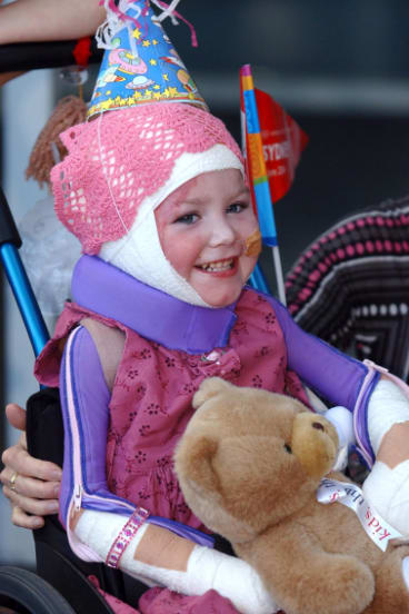 Sophie Delezio leaves the Children's Hospital Westmead in June, 2004.