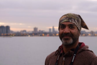 I meet Mohit atop the deck of the Spirit of Tasmania at dawn as it docks in Melbourne.