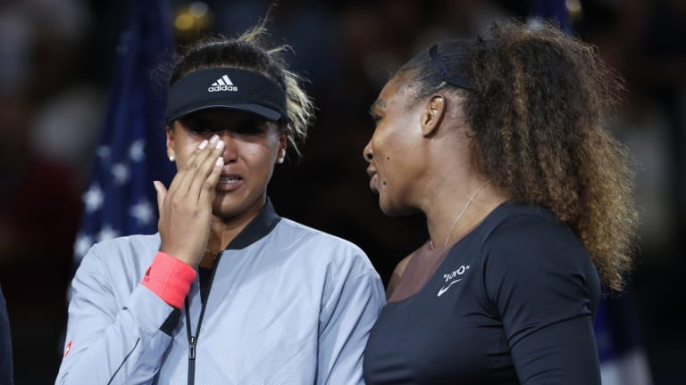 Serena Williams comforts a tearful Naomi Osaka after the women's final of the US Open.