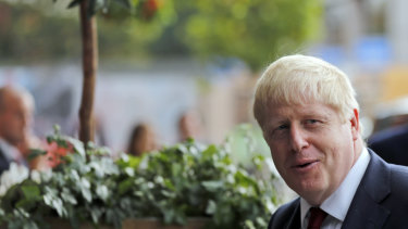 Britain's Prime Minister Boris Johnson arrives at the Conservative Party Conference in Manchester, England.