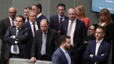 Opposition Leader Anthony Albanese standing with government MPs during the vote.