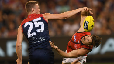 Unorthodox: Essendons Patrick Ambrose approaches his contest with Tom McDonald from a new angle.