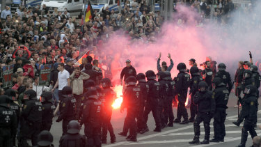 Protesters light fireworks during a far-right demonstration in Chemnitz, Germany, in August.