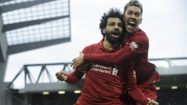 Liverpool's Mohamed Salah, left, and Roberto Firmino celebrate after Tottenham's Toby Alderweireld's own goal.