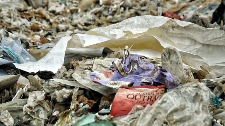 An Australian-branded baby wipes wrapper and a drink cover from Australia are found among the piles of imported plastic wastes at a closed down illegal plastic recycling factory in Jenjarom.
