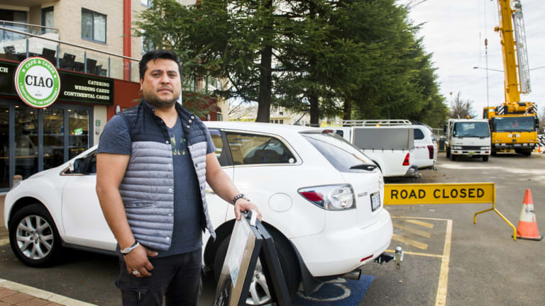 Owner of Ciao at Mort cafe, Ab Guleria is concerned a lack of parking in Braddon due to construction is affecting his business.