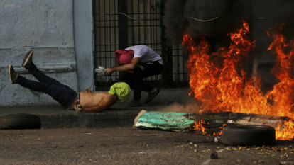 Four dead as fiery skirmishes erupt in Venezuela crisis