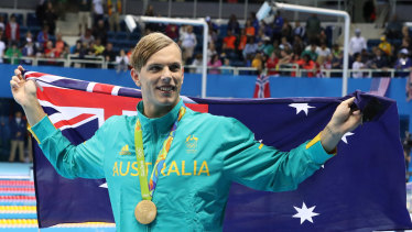 Swimmer Kyle Chalmers celebrates gold in the 100m freestyle at the 2016 Olympics in Rio.