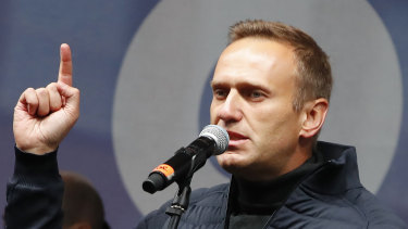 Russian opposition leader Alexei Navalny speaks during a rally to support political prisoners in Moscow, Russia.