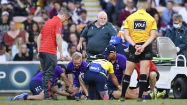 Ryan Papenhuyzen receives medical attention after Tyrell Fuimaono's hit.