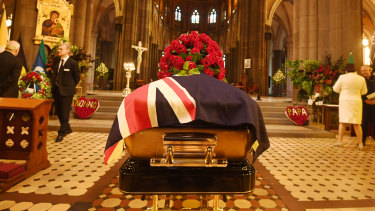 Draped in the Australian flag,  Sisto Malaspina's coffin awaits his state funeral.