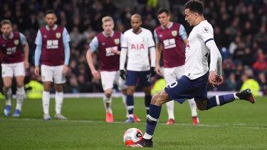 Dele Alli of Tottenham Hotspur scores from the penalty spot against Burnley at Turf Moor.