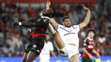Victory substitute Rudy Gestede collects  Wanderers striker Bernie Ibini high. The resulting penalty gave the Wanderers the lead.