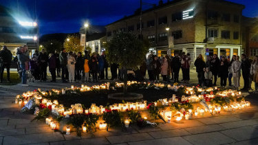 Flowers and candles are placed at the scene of an attack on the Stortorvet in Kongsberg, Norway.