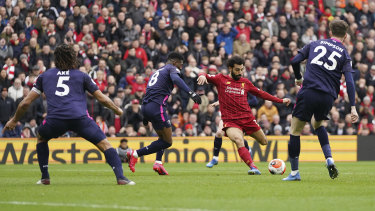 Mohamed Salah strikes from distance for the Reds' opening goal.