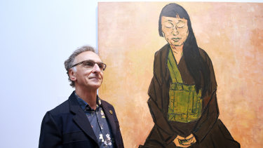 Tony Costa with his Archibald Prize-winning portrait of artist Lindy Lee.