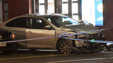 The smashed car at the scene of the incident.